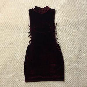 Burgundy suede mini dress with lattice sides.